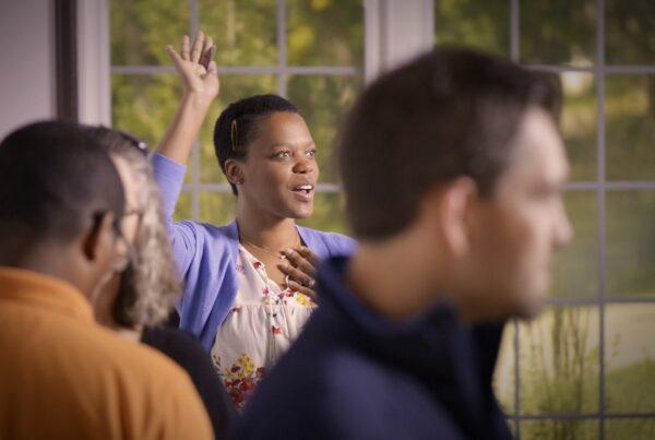Woman Raises Her Hand